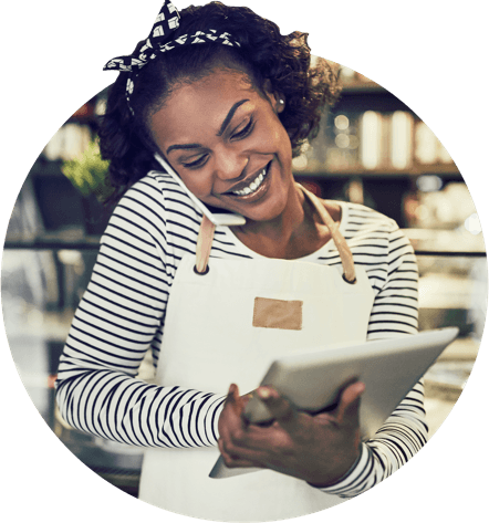 A girl smiling with the credit card