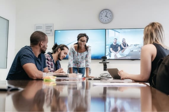 Employees working in a conference room