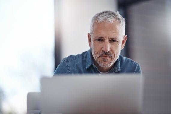 Man Focusing on Laptop