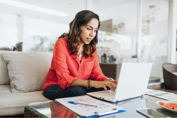 Woman in Living Room on Laptop