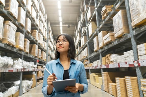 Woman working in a warehouse environment