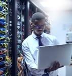 Man next to data servers