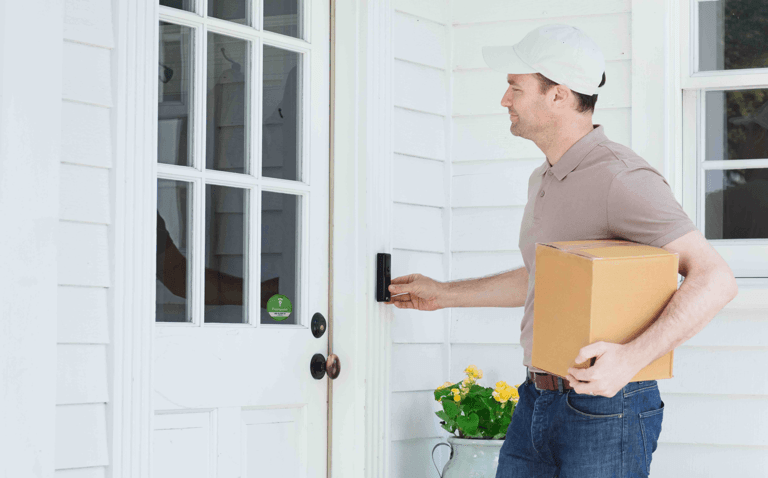 man delivering package to front door