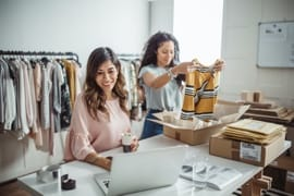 Two working in a small clothing store business.