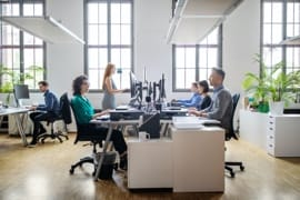 Employees working at desks in a modern office