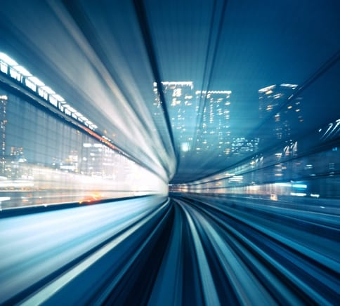 Abstract image demonstrating light and speed within a large city.