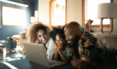family around laptop