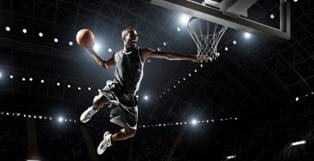 NBA Player Dunking a Basketball