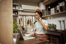 a woman using AT&T phone and internet from home
