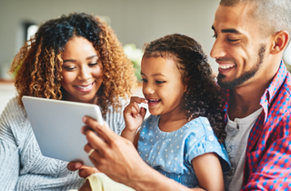 A family using at&t internet on their tablet