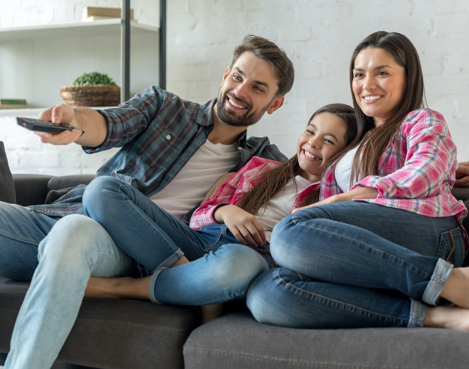 Family watching DIRECTV STREAM