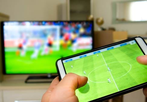 Person playing an online soccer game