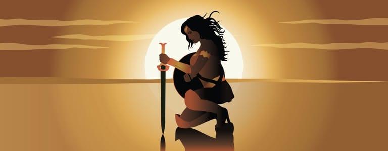 Female superhero at sunset