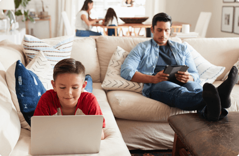 A father and son using different devices
