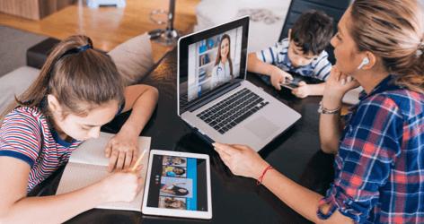 family at table doing homework