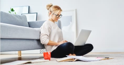 woman with glasses on computer