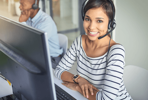 Woman with a headset working in technical support
