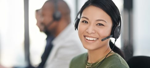 Custome service representative with headset smiling