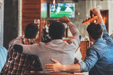 fans cheering at bar