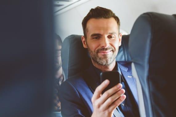 man sitting on plane