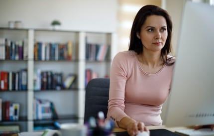 woman watching DISH on desktop