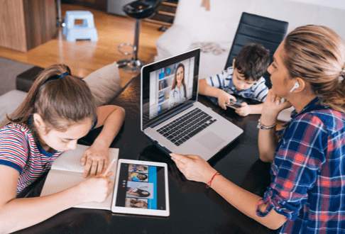 a picture of a family all on internet devices