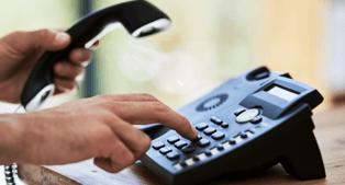 person using a landline phone
