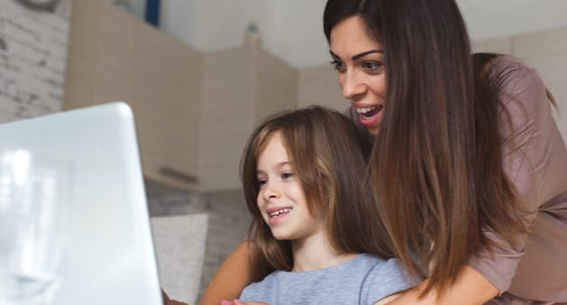 Woman and child looking at computer
