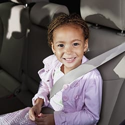 When can a child switch to a regular seat belt?