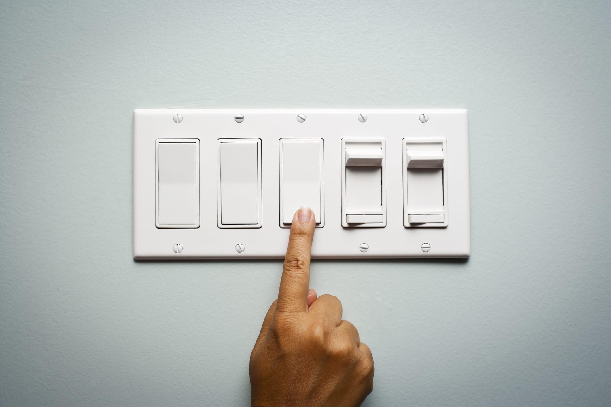 hand flipping light switch