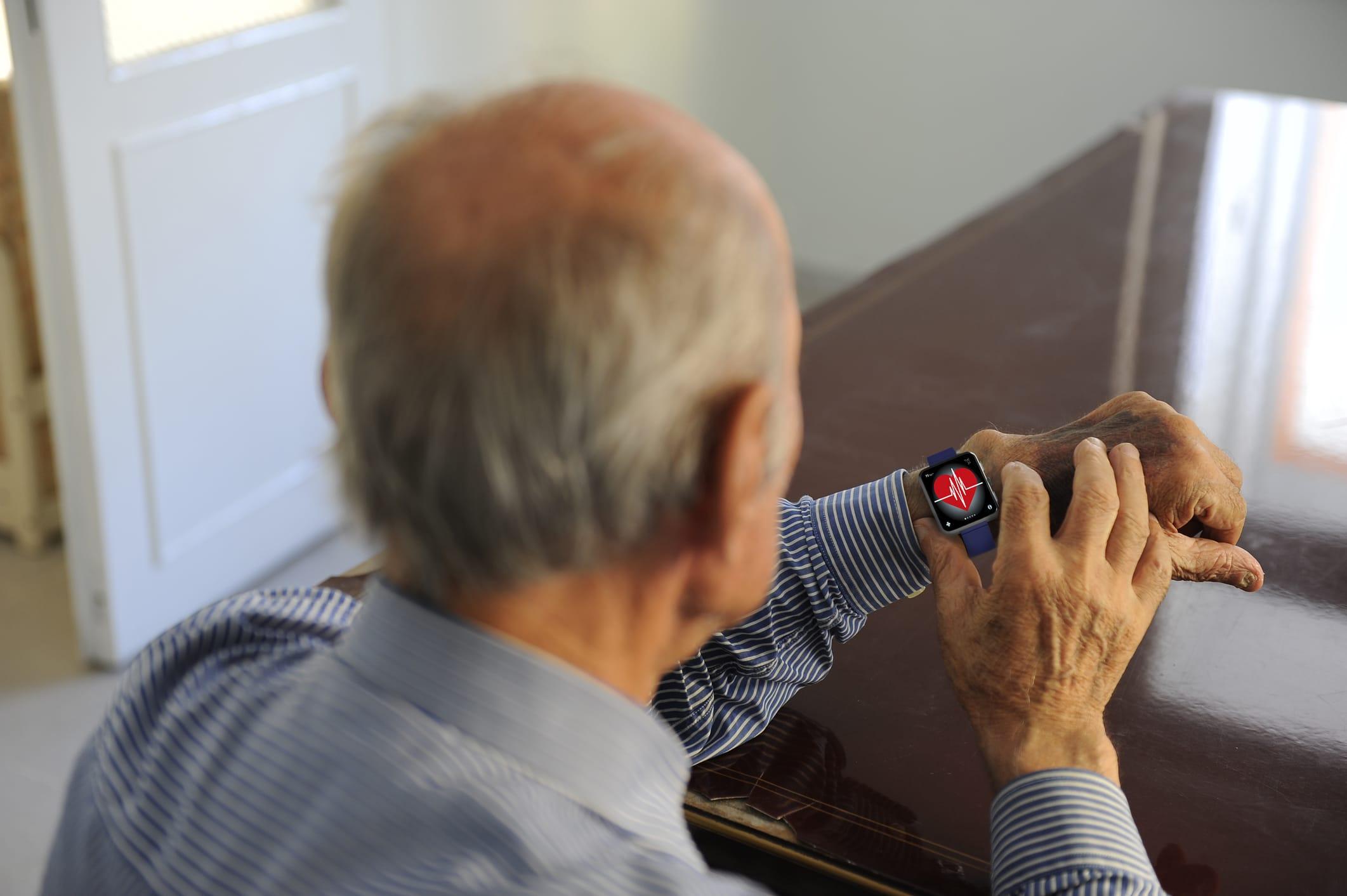 Elderly man and smart watch.