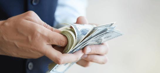 man flipping through money