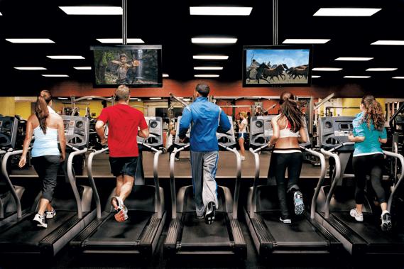 gym members running on treadmills