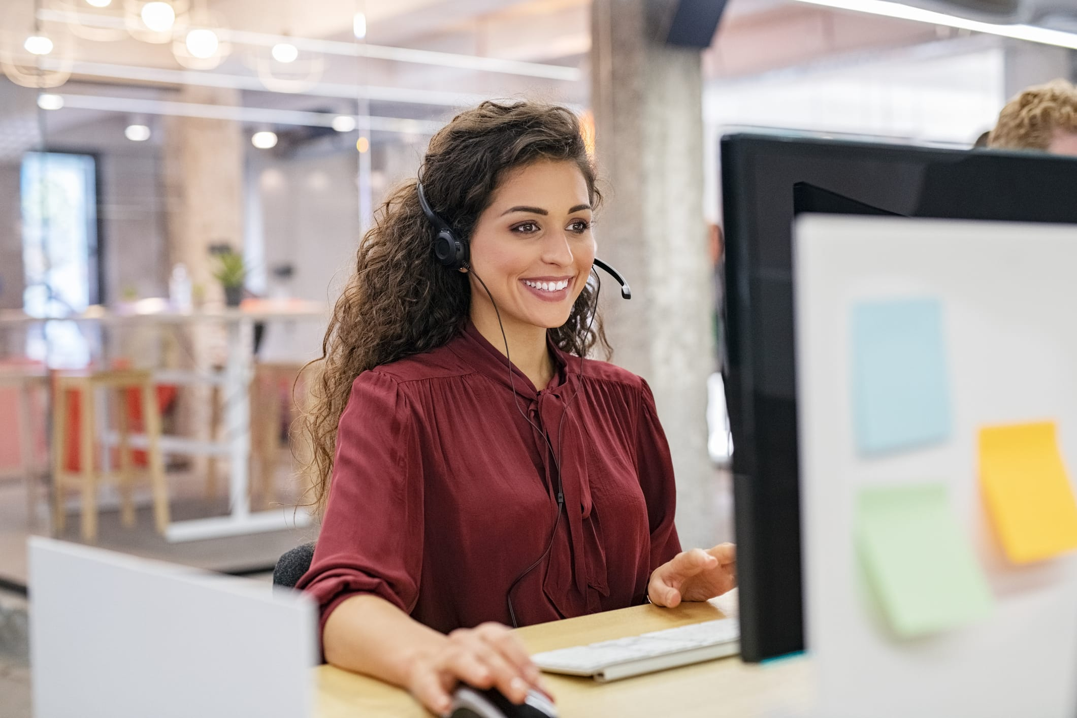 Woman smiling at computer