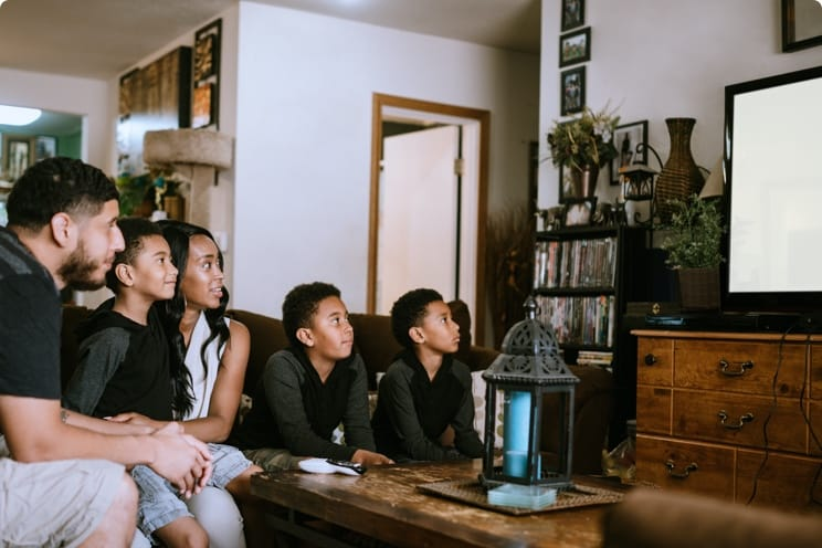 family in living room watching TV