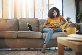 woman on couch using phone