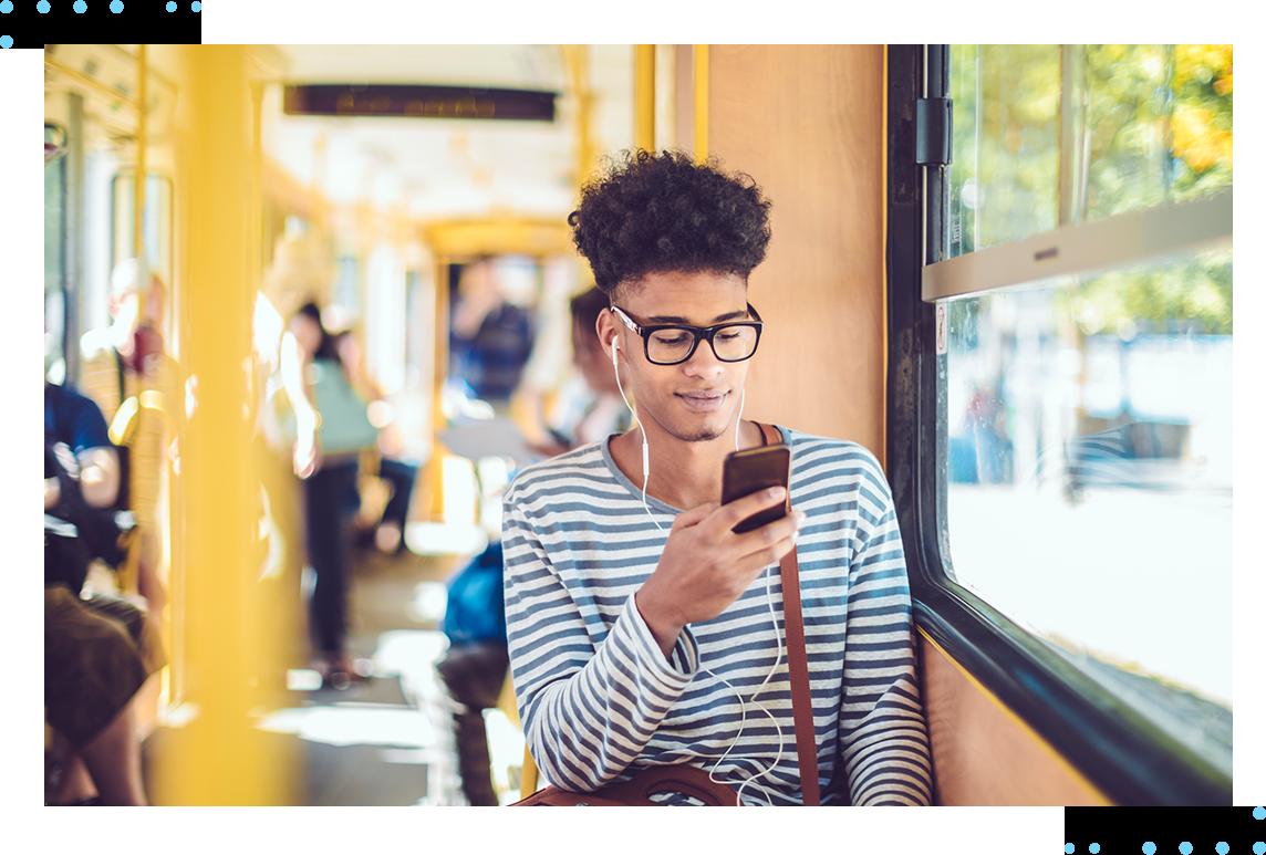 man on train using phone