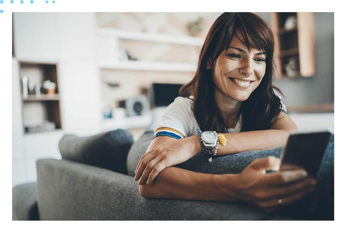 woman on couch looking at phone