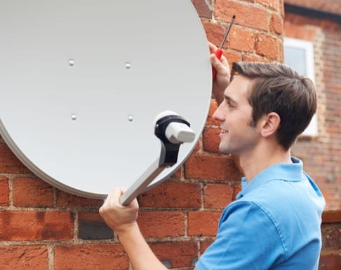 Man installing a satellite