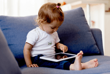 toddler playing on ipad