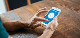 man using vivint app with amazon alexa