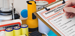 person preparing checklist for natural disaster