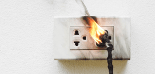 outlet and plug on fire