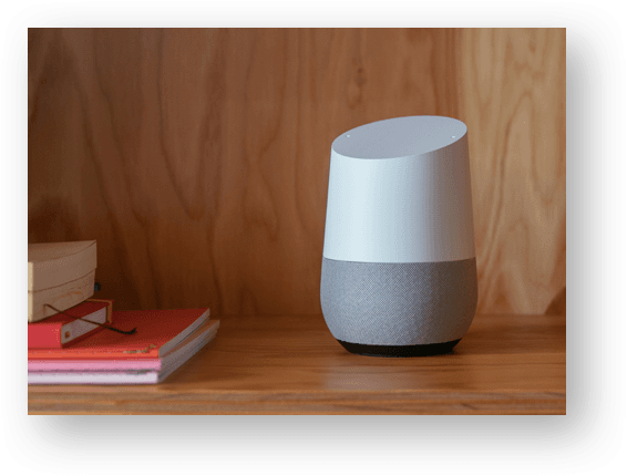 google home device laying on shelf