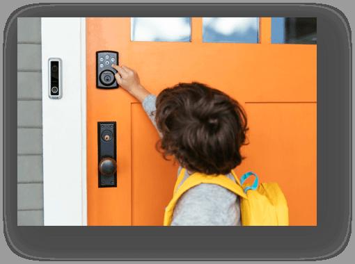 little boy using smart keypad and smart hub on counter