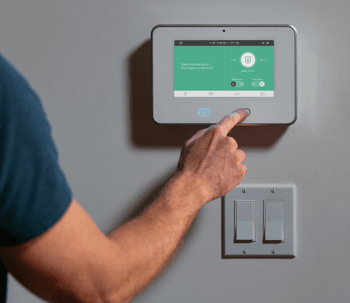 man using the vivint sky control™ panel