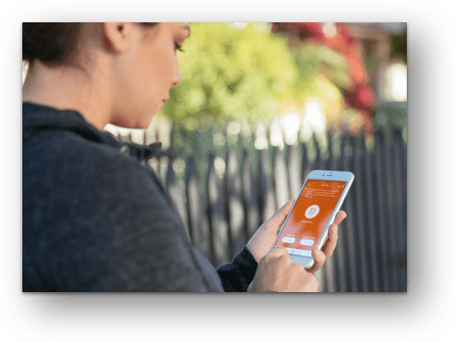 a woman using the vivint mobile app on her phone