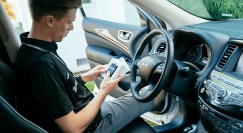 A technician installing a security camera