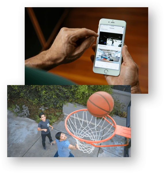 Father recording video clips using Vivint Playback™ of two sons playing basketball.