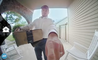 Delivery man pushing the doorbell